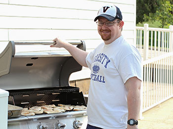 Staff at the Child Services Center meets standards for supervision, safety and nutrition while enjoying activities like grilling out with students.