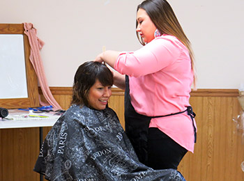 Winona provided haircuts free of charge throughout the day.